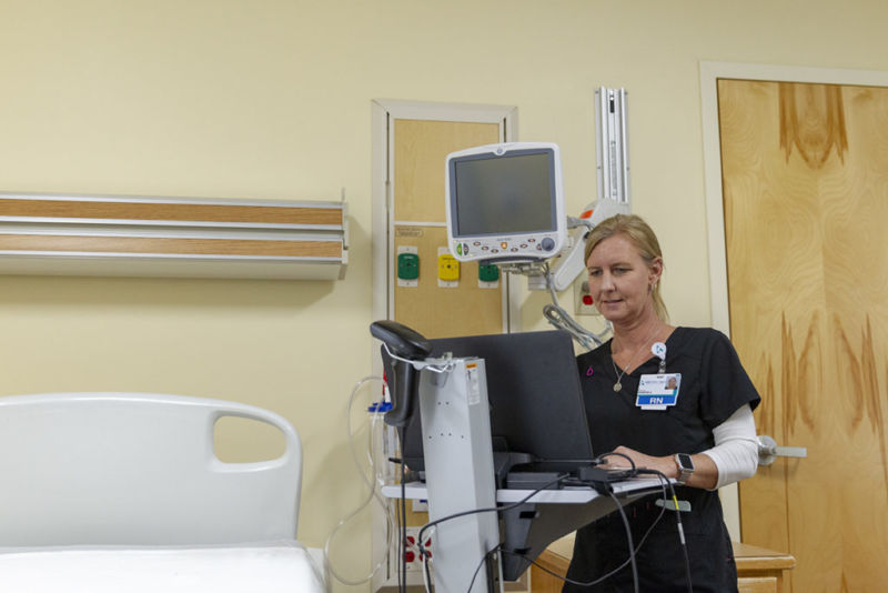 Jennifer Alexander, RN, BSN, logs patient information into the athenahealth system.