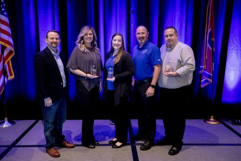 TeleChoice Award winners stand together